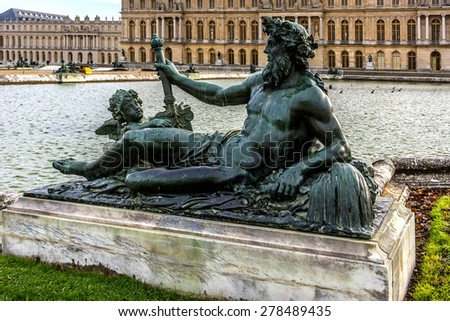 Sculptures in the famous Versailles Palace Park. The Palace of Versailles was a royal chateau. It was added to the UNESCO list of World Heritage Sites. Paris, France. - stock photo