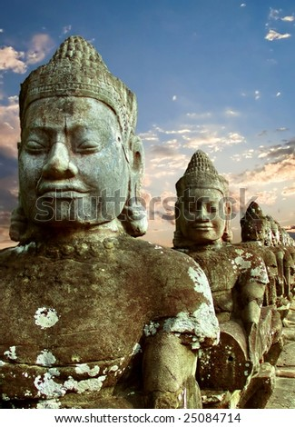 Sculptures of demons of Asia. Photographed in the temple complex of Angkor Wat, Cambodia - stock photo