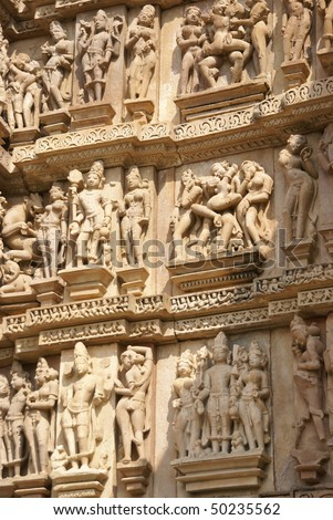 Sculptures of loving couples, maithuna, mythical figures on outer walls of  Visvanatha Temple at  Khajuraho,  India