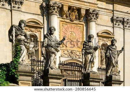 Sculptures of saints. Architectural details of the Church of the Apostles St. Peter and Paul in old town in Krakow, Poland. - stock photo