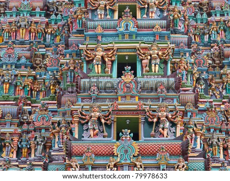 Sculptures on Hindu temple gopura (tower). Menakshi Temple, Madurai, Tamil Nadu, India