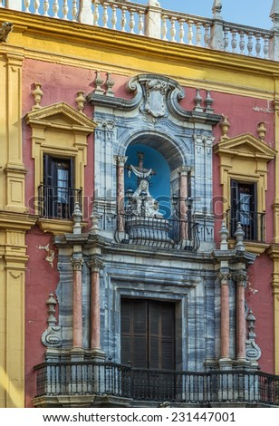sculptures on the facade of the Episcopal Palace in Malaga, Spain - stock photo