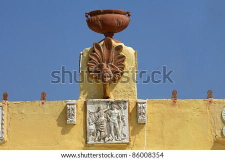 Sculptures on the roof of a house in a traditional Greek village of Zia. Kos Island, Greece - stock photo