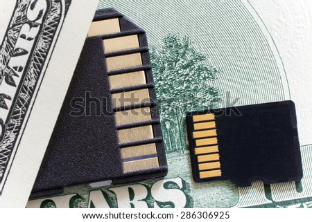 sd and micro sd card on the money - stock photo