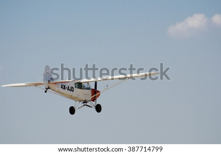 SDE TEYMAN, ISRAEL - DECEMBER 28, 2012: AircraftPiper PA-18-150 Super Cub on fly on the backgroynd of the sky