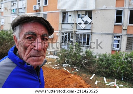 SDEROT, ISR - FEB 18 2008:Palestinian rocket hits Israeli building.Since 2001 over 15,000 rockets hit Israel killed 28 injured 1900 people widespread psychological trauma and disruption of daily life. - stock photo