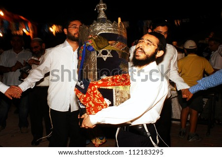 SDEROT, ISRAEL - OCTOBER 14 2006:Orthodox Jewish Men celebrate Simchat Torah in Sderot, Israel. Simchat Torah is a celebratory Jewish holiday marks the completion of the annual Torah reading cycle. - stock photo