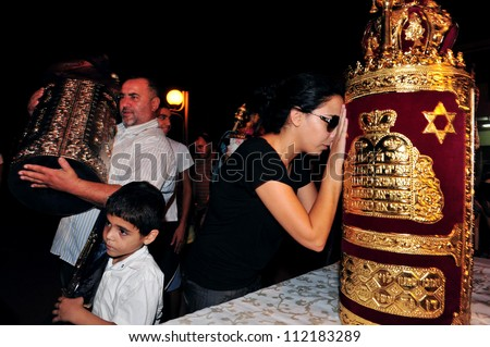 SDEROT ISRAEL - SEPTEMBER 30:Israeli men and women celebrate Simchat Torah in Sderot, Israel. Simchat Torah is a celebratory Jewish holiday marks the completion of the annual Torah reading cycle - stock photo