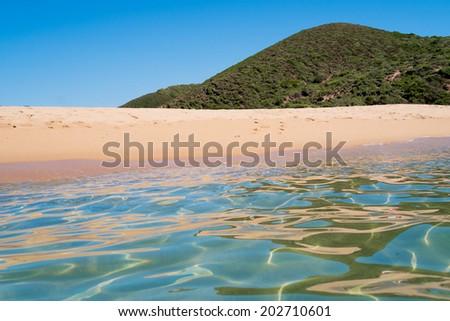 Sea and beach along green coast, west Sardinia, Italy - stock photo