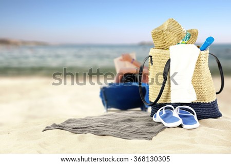 sea and beach background with summer bag
