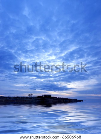 Sea and big cloud with island in the middle - stock photo