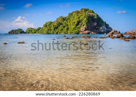 Sea and blue sky with tiny clouds - stock photo