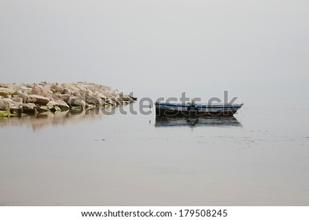 sea and boat landscape background.boat in the dock of the bay. - stock photo