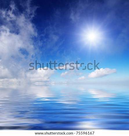 Sea and bright sky with clouds and sun.