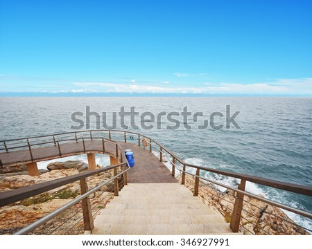 sea and cliff path for visitor - stock photo