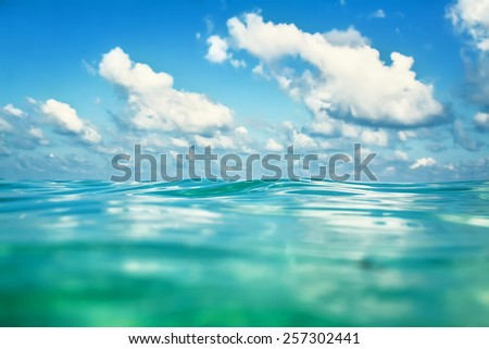 Sea and clouds. Focus on the wave - stock photo