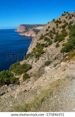 sea and mountains landscape with blue sky