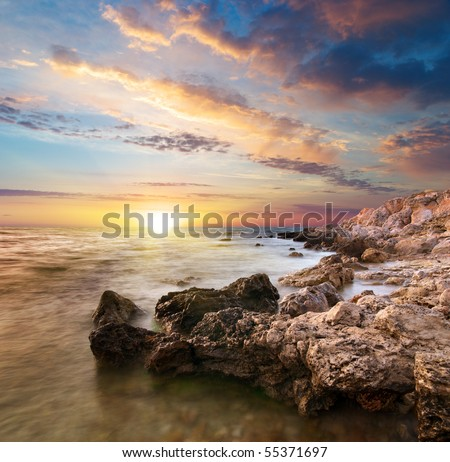 Sea and rock at the sunset. Nature composition. - stock photo