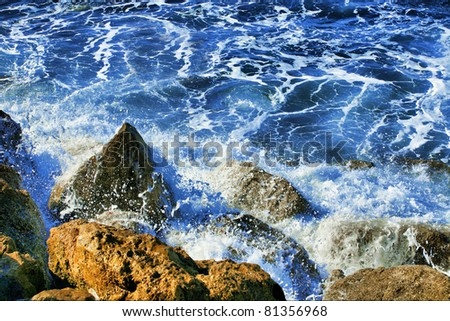 Sea and rock at the sunset. Nature composition - stock photo