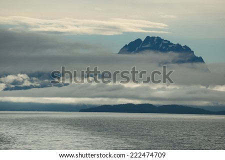 Sea and snow capped mountains near Valdez Arm, Alaska  - stock photo