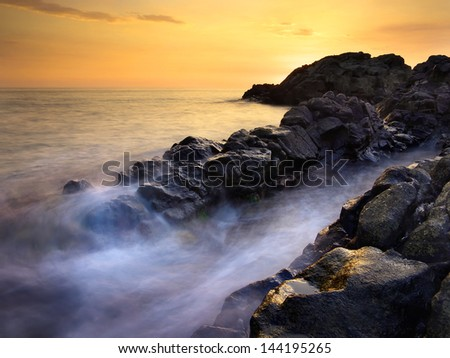 Sea and stones. Beautiful seascape during sunset