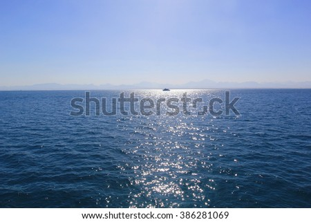 sea and sun reflecting in the sea - background