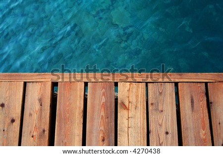 sea and wooden dock - stock photo