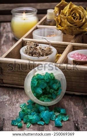 sea aromatic salt for Spa treatments on the background of yellow rose buds - stock photo