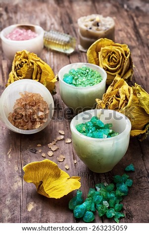 sea aromatic salt for spa treatments on the background  yellow rose buds - stock photo