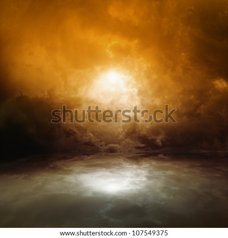 Sea background - dark red moody sky with reflection in water - stock photo