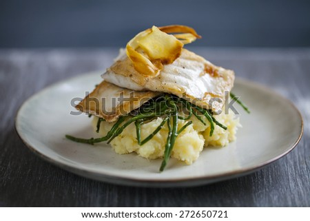 Sea bass fillet on parsnip mash and samphire with parsnip crisp - stock photo