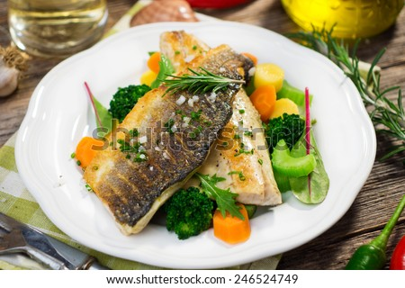 Sea bass fillet with vegetables   - stock photo