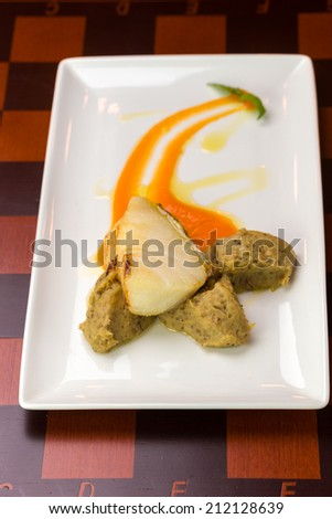 Sea bass fish fillet on the table - stock photo