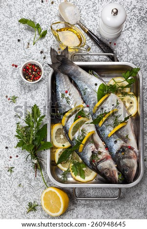 Sea bass with lemon,herbs and persian blue salt before cooking - stock photo
