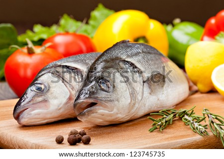 Sea Bass with the vegetables  and lemon - stock photo