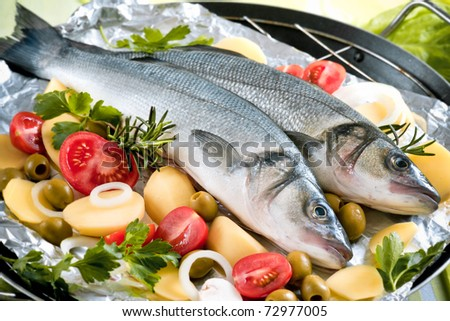 Sea-bass with the vegetables on a grill - stock photo