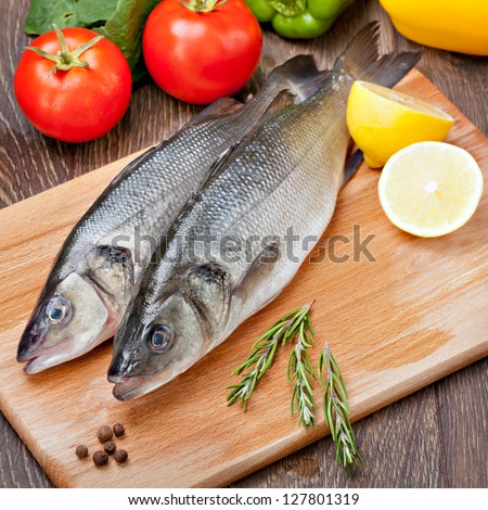 Sea Bass with vegetables and  lemon - stock photo