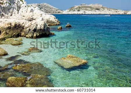 Sea bay of the island dIf and island Frioul at the horizon - stock photo