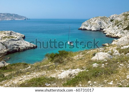 Sea bay of the island Frioul with sailboat - stock photo