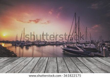 Sea bay with yachts on wooden floor.For product display - stock photo