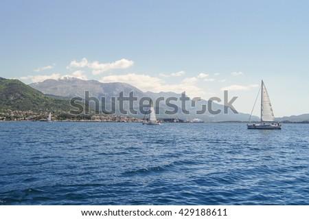 "Sea bay with yachts. Tivat, Montenegro - 26 April, 2016. Regatta ""Russian stream"" in God-Katorskaya bay of the Adriatic Sea off the coast of Montenegro. - stock photo"