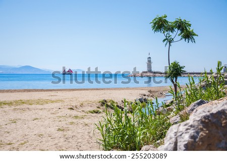 Sea beach and lighthouse in Alanya, Turkey. Beautiful summer landscape - stock photo