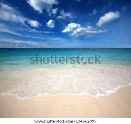 sea beach blue sky sand sun daylight relaxation landscape viewpoint for design postcard and calendar in thailand - stock photo