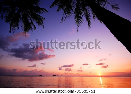 Sea beach sunset background travel thailand coconut nature - stock photo