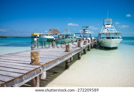 Sea boats at the Contoy island in the Caribbean sea - stock photo
