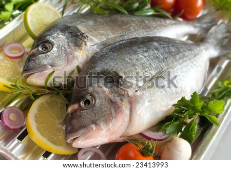 sea bream fish with the vegetables on a grill - stock photo