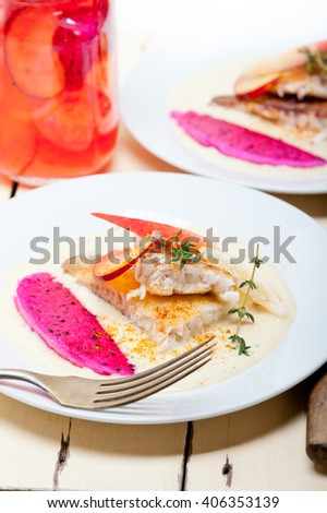 sea bream orata  fillet butter pan fried with fresh peach prune and dragonfruit slices thyme on top - stock photo