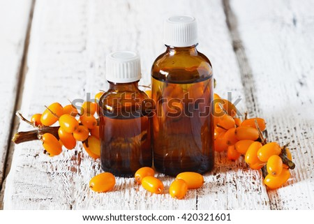 Sea buckthorn oil in small bottles.  Alternative medicine. Selective focus - stock photo