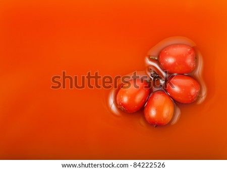sea-buckthorn oil with fresh berries seabuckthorn surface top view - stock photo