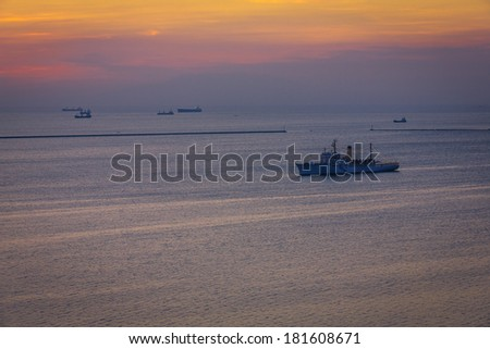 sea cargo ship at the sunset